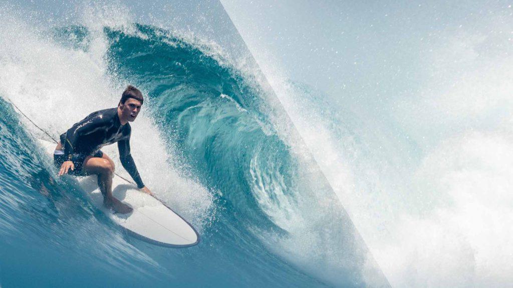 Surfer auf Torq Surfboard